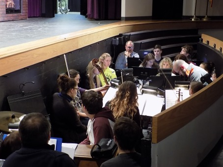 Student and community orchestra practice for spring musical
